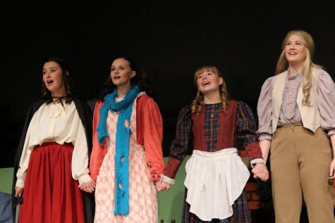 The four March sisters Meg (played by Mackenzie Russell), Amy (played by Lorena Tomasic),  Beth (played by Emma VanBrocklin),  and Jo (played by Emma Prentice).