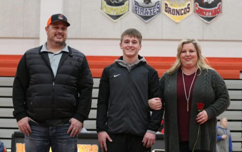Senior Gage Maxwell and his parents, Brad and Kelly, enjoy senior night festivities on Jan. 30.